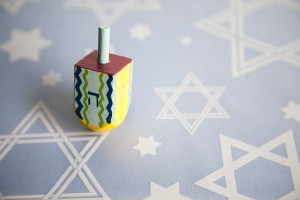 dreidel on magen david table cloth
