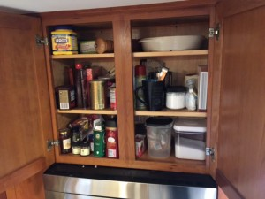 Kelly's baking cabinet full (and disorganized) in need of a Spring Cleaning.