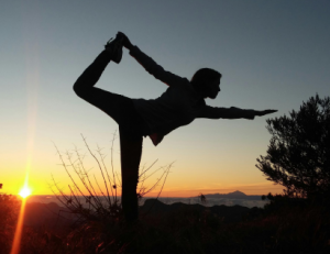 peace and balance visual standing pose at sunset