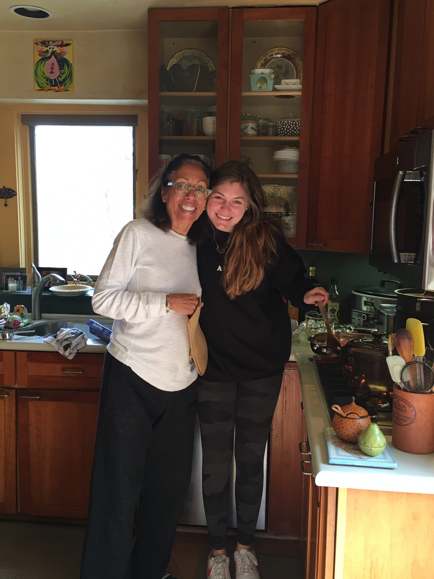 Joy and grand-daughter, Gefen cooking quiche.
